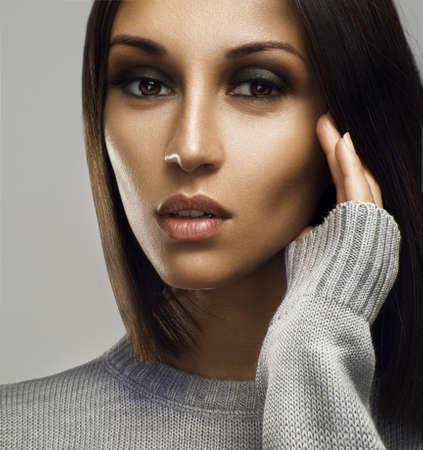 highlighting: Beautiful woman face. Perfect makeup. Beauty fashion. Eyelashes. Cosmetic Eyeshadow. Highlighting