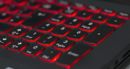 Gaming laptop with red backlit numpad online.