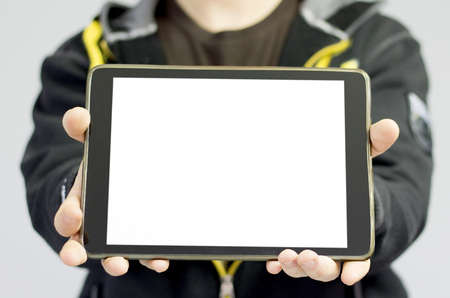 blank tablet: Man holding a tablet with blank copy space.