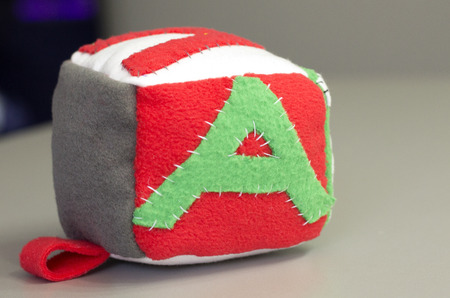 Handmade colorful soft block toy with letters for baby.