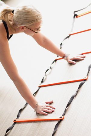 Agility ladder in use during fitness class.