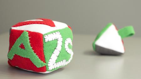 Stuffed handmade gift for newborn baby - soft blocks. Stock Photo