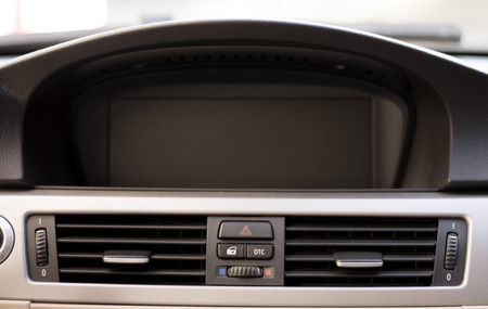 Luxury cars inside screen navigation display and climatization. Stock Photo