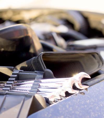 dismantle: Useful fixing utensils for broken car - metal wrench. Stock Photo
