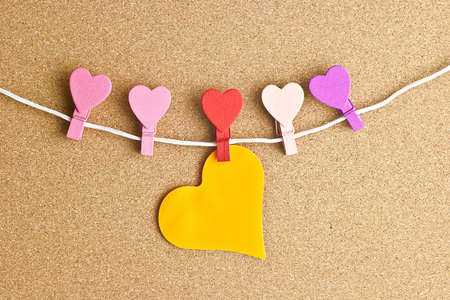 Hearts pinned to the peg on the bulletin board photo