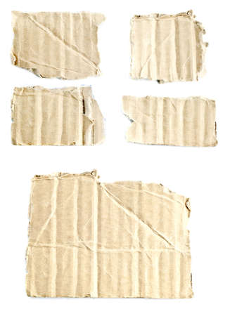 Broken pieces of cardboard boxes on a white background, macro photo Stock Photo - 7912289