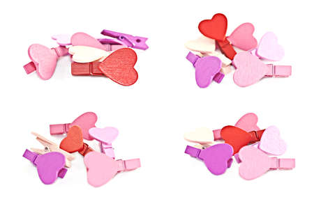 macro photography: Colorful wooden pegs with a heart on a white background. Macro photography.