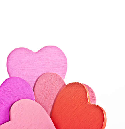 macro photography: Colorful wooden  heart on a white background. Macro photography. Stock Photo
