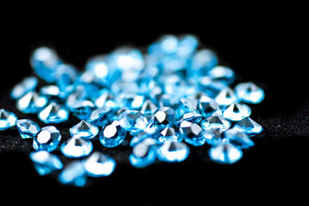On a black background, blue diamonds, the focus is in the middle. Stock Photo - 8062046