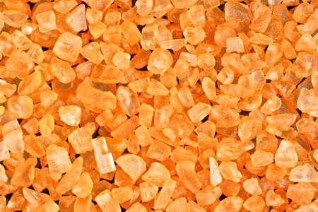 bath salts: Bath salts with orange extract on a black background. Macro photography.