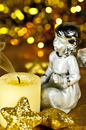 ceased: Christmas angel staring at the candle