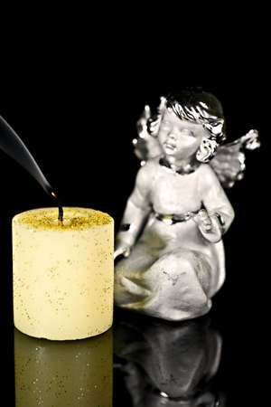 ceased: Christmas angel staring at the candle was extinguished.
