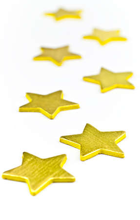 On a white background, gold stars all in a horizontal position photo