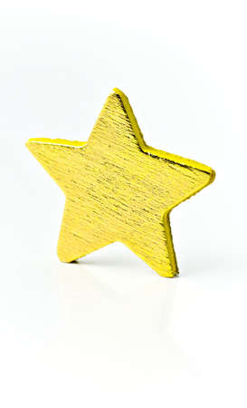 Isolated on white background a bright golden star. photo