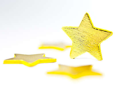 On a white background golden stars, one star in a vertical position. photo