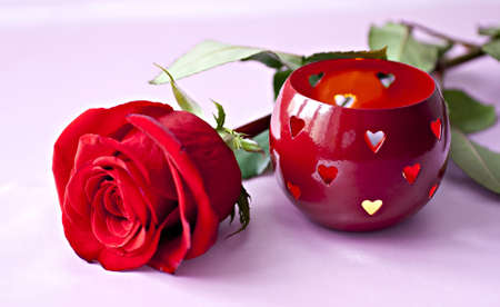 candle holder: Beautifull red rose with romantic heart shaped candle holder. Stock Photo