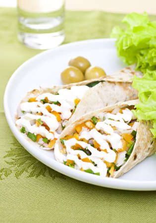 Served wheat wraps with olive, filled with salad, crab meat and mayonnaise. photo