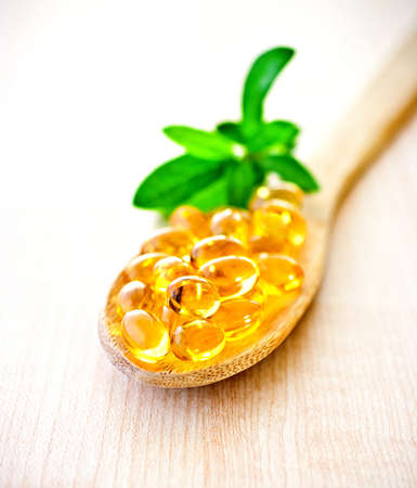 Fish oil a wooden spoon.