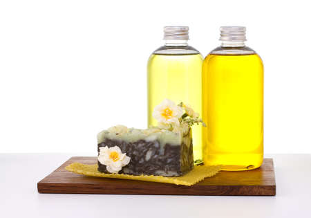 grooming product: Natural soaps with oil isolated on the white background.