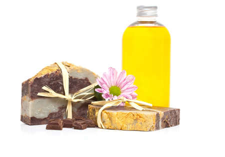Homemade chocolate soap and jojoba oil. Isolate on a white background. Stock Photo