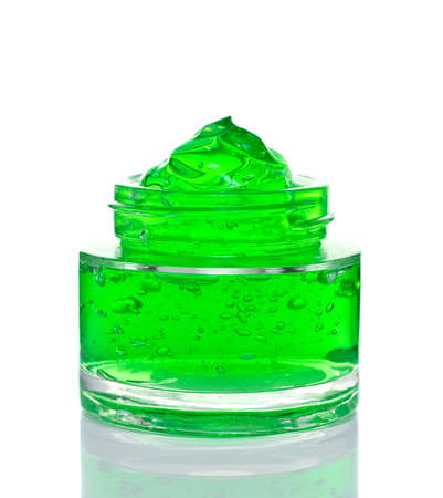 Aloe vera gel glass jar isolated on white background.