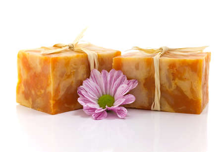handmade soap: Natural handmade soap and pink flower, on a white background. Stock Photo