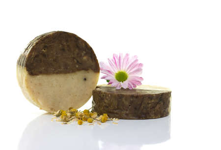 Natural handmade soap and pink flower, on a white background. photo