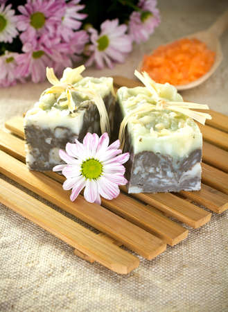 natural soap: Natural soap, handmade. Pink flowers and spoon with sea salt. Stock Photo