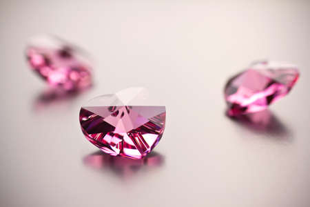 a precious: Pink crystal hearts on a gray background.