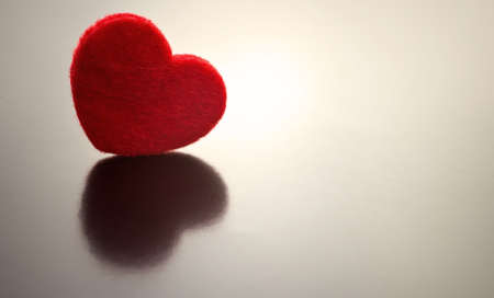 One red hearts on a gray background. Stock Photo - 10507419