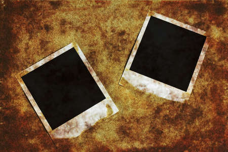 Old instant camera photo frames on the grunge background.