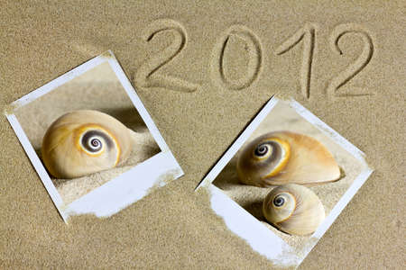 Polaroid photographs of shell sand images and text in 2012 year. photo