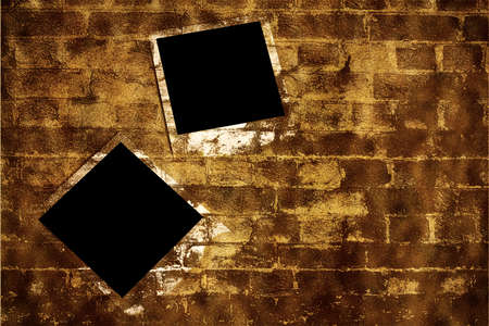 Old instant camera photo frames on the brick wall grunge background. Reklamní fotografie