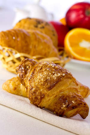 Tasty breakfast  Croissants and fresh fruit  photo