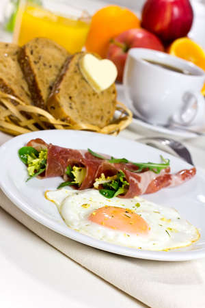 Breakfast, bread with a heart of butter, fried eggs with bacon and coffee  Stock Photo