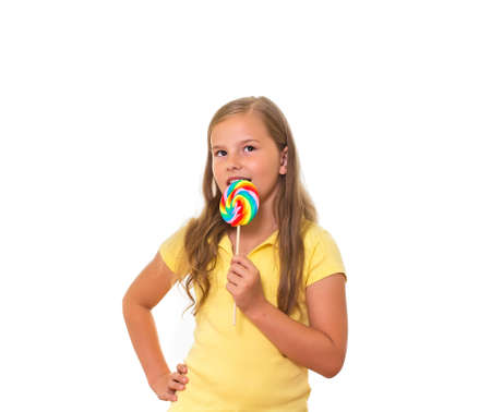 A young girl eating lollipop  photo