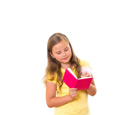 Girl holds the pink note pad Stock Photo - 14702761