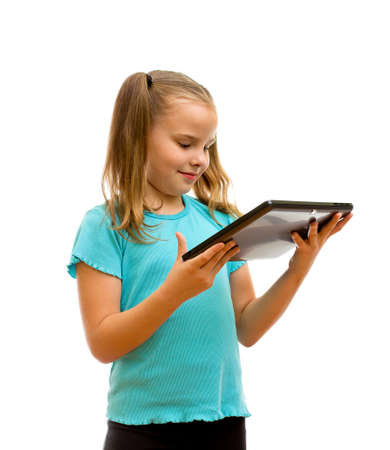 Girl using tablet PC  isolated on the white background. photo