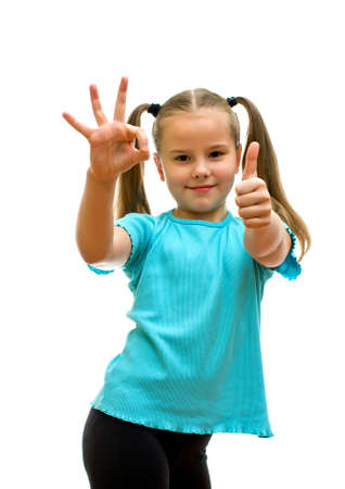 two thumbs up: Girl with thumbs up, isolated on the white background. Stock Photo