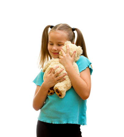 doctor holding gift: Girl playing with soft teddy bear, isolated on the white background.