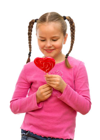 Girl with heart-shaped candy on a white background  photo