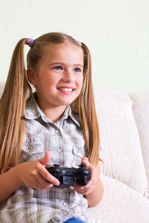 teenaged girl: A teenaged girl playing video, computer  game.