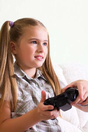 teenaged girl: A teenaged girl playing video, computer  game  Stock Photo
