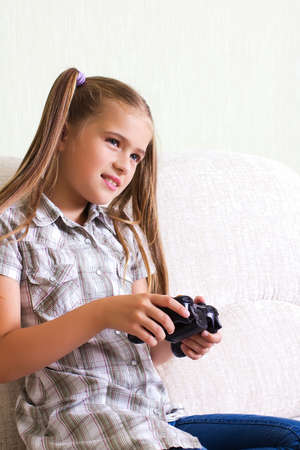 pre adolescent girls: A teenaged girl playing video, computer  game  Stock Photo