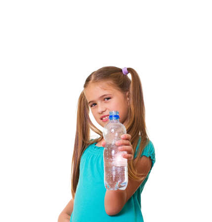 pre adolescence: Portrait of happy girl with water from plastic bottle isolated on white background Stock Photo