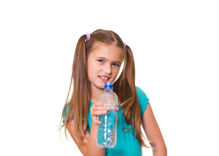 Portrait of happy girl with water from plastic bottle isolated on white background Stock Photo