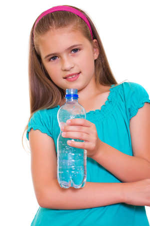 Portrait of happy girl with water from plastic bottle isolated on white background photo