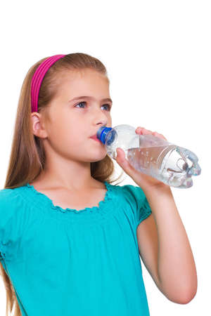 pre teens: Portrait of happy girl with water from plastic bottle isolated on white background Stock Photo