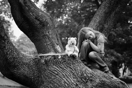 Young girl sitting in a park  Black and white photography  photo