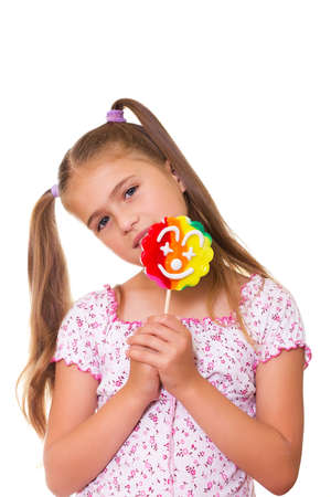 sucking lollipop: Girl and a lollipop, isolated on the white background  Stock Photo
